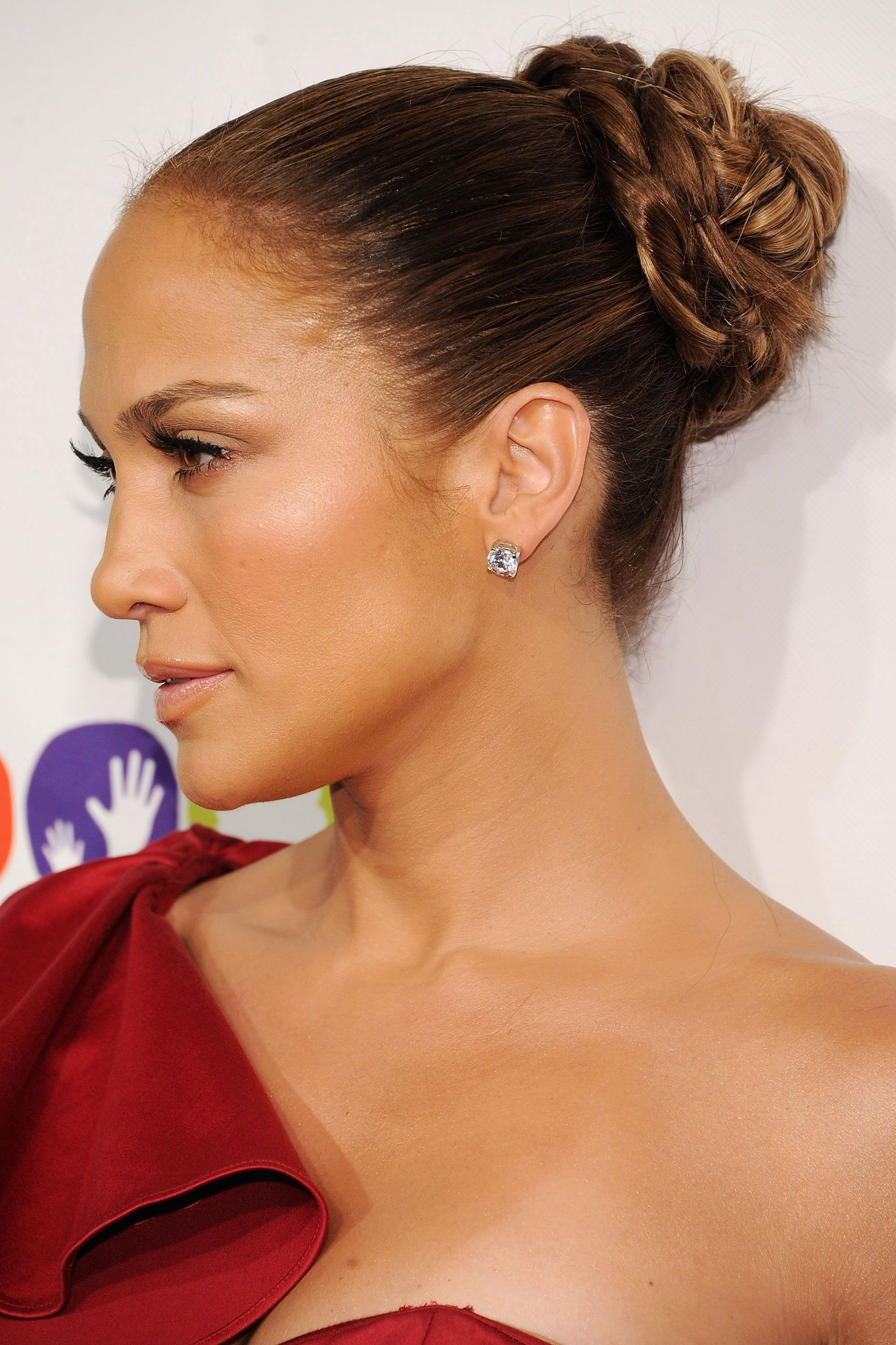 "<p>If you've ever braided the end of your ponytail before, you can easily recreate Jennifer Lopez's same look with one extra step, according to <a href=""https://www.joico.com/"" target=""_blank"">Joico</a>'s celebrity hairstylist, <a href=""https://www.instagram.com/paulnortonhair/?hl=en"">Paul Norton</a>. Start by gathering your hair into a high pony, braiding it, and securing the end with a hair tie. Then, wrap the lengthy braid around the base of your ponytail, anchoring it down with bobby pins. Keep the braid tight and polished or give it more texture by gently tugging the braid apart before wrapping it up and around the pony. </p><p><strong data-redactor-tag=""strong"" data-verified=""redactor"">RELATED: <a href=""http://www.redbookmag.com/beauty/hair/advice/g2449/braided-hairstyle/"" target=""_blank"">53 Braided Hairstyles That Are Anything But Boring</a></strong><span class=""redactor-invisible-space""><strong data-redactor-tag=""strong"" data-verified=""redactor""><a href=""http://www.redbookmag.com/beauty/hair/advice/g2449/braided-hairstyle/""></a></strong></span><br></p>"