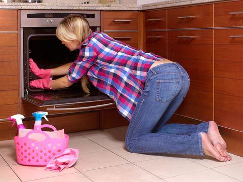 Denim, Jeans, Major appliance, Oven, Floor, Kitchen, Flooring, Cabinetry, Kitchen appliance, Plaid,