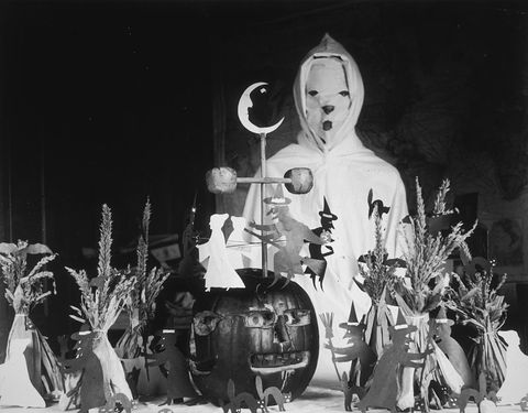 "<p>Back in the early 1900s, your costume options were certainly limited, but your decorations were not. We'll focus on the positives here (instead of the horrifying):&nbsp;Those little black cats are adorable.&nbsp;</p><p><a href=""http://www.goodhousekeeping.com/holidays/halloween-ideas/g3848/pun-halloween-costume-ideas/"" target=""_blank""><em data-redactor-tag=""em"">See more creative Halloween costumes&nbsp;»</em></a> <span class=""redactor-invisible-space"" data-verified=""redactor"" data-redactor-tag=""span"" data-redactor-class=""redactor-invisible-space""></span><br></p>"