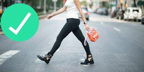 Clothing, Footwear, Trousers, Human leg, Outerwear, T-shirt, Street fashion, Asphalt, Denim, Bag,