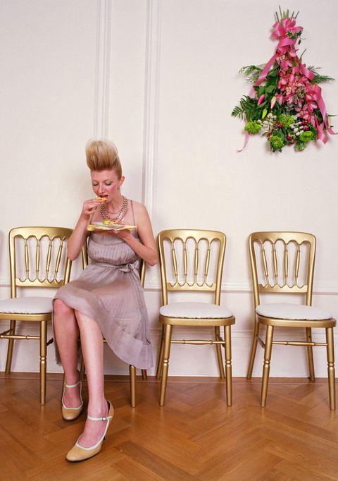woman alone eating at wedding