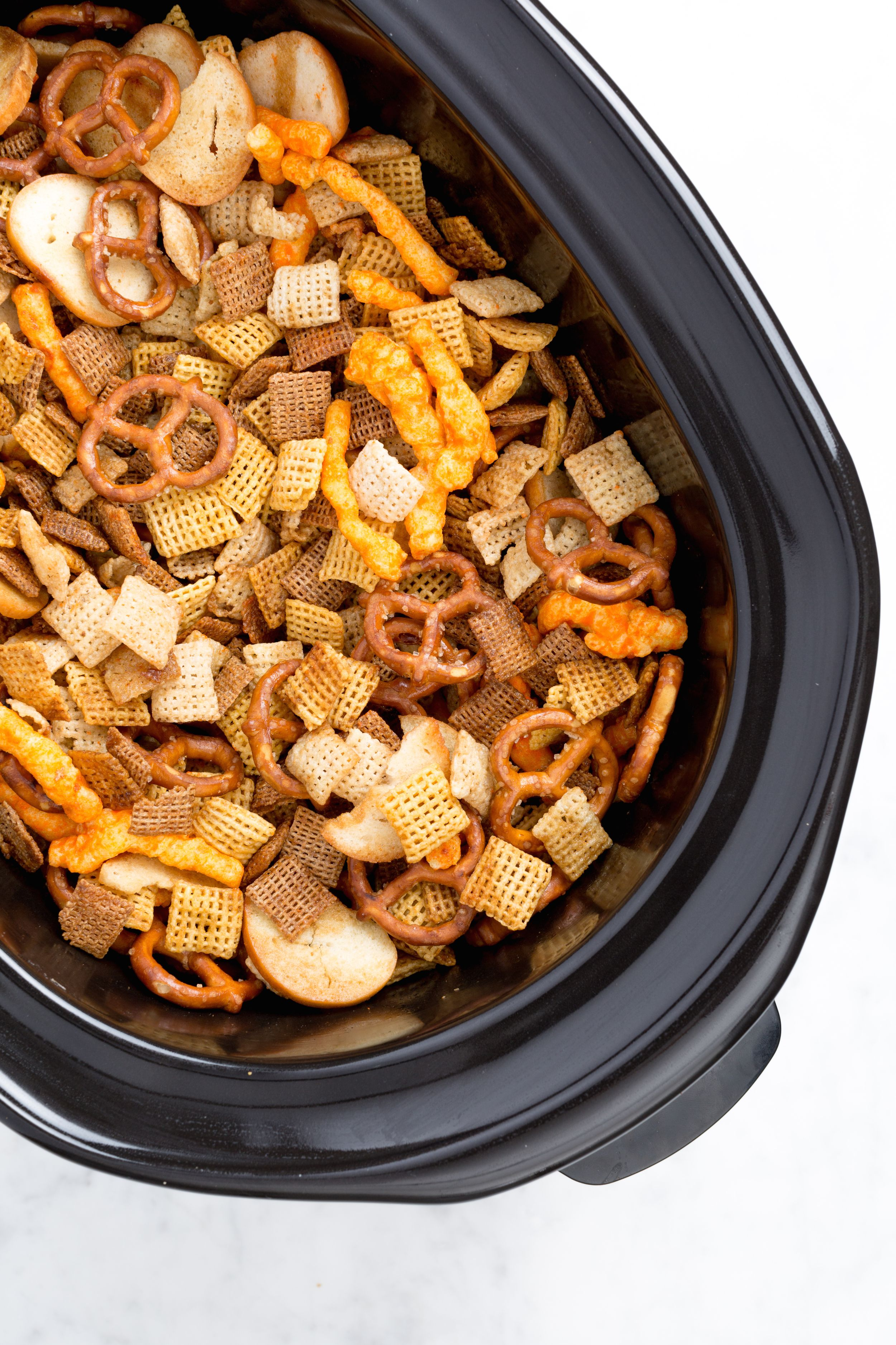 """<p>If you're still just using your slow cooker for dinner, you're totally missing out. Instead of phoning it in with store-bought Chex Mix, prep a big batch of the homemade kindin your slowcooker to keep your party guests satisfied all night long.</p><p>Get the recipe from <a href=""""http://www.delish.com/cooking/recipe-ideas/recipes/a44362/slow-cooker-chex-mix-recipe/"""" target=""""_blank"""">Delish</a>.</p>"""