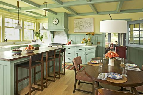 "<p>Okay. Deep breaths. We know the thought of a kitchen this bright and two-toned might be terrifying, but in actuality, it can create a wonderfully welcoming atmosphere. ""Painting the paneling green cheers up the room, while the soft, buttery yellow of the walls and window trim mellows out the acidity of the color,"" explains Hendricks.</p><p><br> </p><p><strong data-redactor-tag=""strong"">Scrimp On a Kitchen Rug</strong><br>It's going to take a beating anyway. ""Besides, it's fun to swap out the rug every now and then, like you would throw pillows on a couch,"" notes Hendricks. We love indoor-outdoor runners from Dash and Albert (Safavieh handwoven rug, $154 for 8' x 10'; <a href=""https://www.overstock.com/"" target=""_blank"" data-tracking-id=""recirc-text-link"">overstock.com</a>; Phoenix Wool Dhurrie rug, from $59; <a href=""http://www.westelm.com/products/phoenix-dhurrie-regal-blue-t1068/"" target=""_blank"" data-tracking-id=""recirc-text-link"">westelm.com</a>), or look for inexpensive dhurrie or kilim options on Etsy and eBay. </p><p><br> </p><p><strong data-redactor-tag=""strong"">Keep the Art Simple<br></strong>A minimalist drawing won't overpower architectural details. (Drawing by Emma Lawrenson, $103; <a href=""https://www.etsy.com/listing/272823956/original-drawing-screenprint-of-a-simple?ref=shop_home_active_33"" target=""_blank"" data-tracking-id=""recirc-text-link"">littleprintpress.etsy.com</a>; Gallery Solutions frame,  $34.99 for 11"" x 14""; <a href=""http://www.target.com/p/gallery-solutions-single-image-frame-black/-/A-50069017"" target=""_blank"" data-tracking-id=""recirc-text-link"">target.com</a>) </p><p><br> </p><p><strong data-redactor-tag=""strong"">Combine Comfort and Style<br></strong>When guests congregate in the kitchen, the seating oughta be comfy. (Sophia Barstool, $299 for 2; <a href=""http://www.worldmarket.com/product/espresso-sophia-bonded-leather-barstools-set-of-2.do"" target=""_blank"" data-tracking-id=""recirc-text-link"">worldmarket.com</a>) </p>"