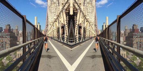Bridge, Pedestrian, Iron, Parallel, Metal, Guard rail, Symmetry, Fence, Lane, Building material,