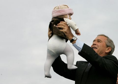 LITITZ, PA - OCTOBER 27:  U.S. President George W. Bush holds up a baby during a campaign rally at Lancaster Airport October 27, 2004 in Lititz, Pennsylvania. Polls show that Bush is in a neck and neck race with his challenger, Democratic presidentail nomminee Sen. John Kerry (D-MA), with less than a week to go before the November 2 election.  (Photo by Mark Wilson/Getty Images).
