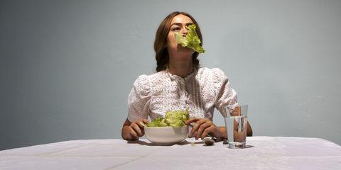 woman eating lettuce