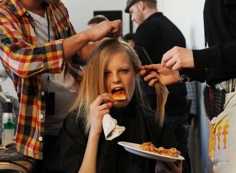 "<p>While getting her <em data-redactor-tag=""em"" data-verified=""redactor"">hair did</em> backstage at Donna Karan, Gaby went HAM on a slice.</p>"