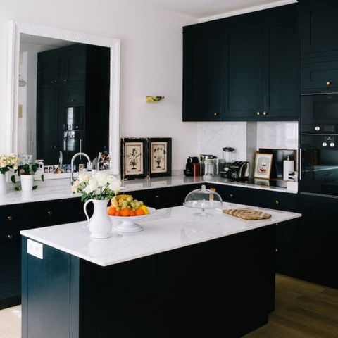 "<p>Yes, the matte black cabinetry is incredibly sleek, but you know what's really genius here? The mirror hanging over the sink to mimic a window.&nbsp;</p><p><span class=""redactor-invisible-space"" data-verified=""redactor"" data-redactor-tag=""span"" data-redactor-class=""redactor-invisible-space""><span class=""redactor-invisible-space"" data-verified=""redactor"" data-redactor-tag=""span"" data-redactor-class=""redactor-invisible-space""></span></span></p><p><strong data-redactor-tag=""strong"" data-verified=""redactor"">See more at&nbsp;</strong><span class=""redactor-invisible-space"" data-verified=""redactor"" data-redactor-tag=""span"" data-redactor-class=""redactor-invisible-space""><strong data-redactor-tag=""strong"" data-verified=""redactor""><a href=""http://cupofjo.com/2016/12/paris-apartment-tour-sezane-morgane-sezalory/"" target=""_blank"" data-tracking-id=""recirc-text-link"">Cup of Jo</a>.</strong></span></p>"