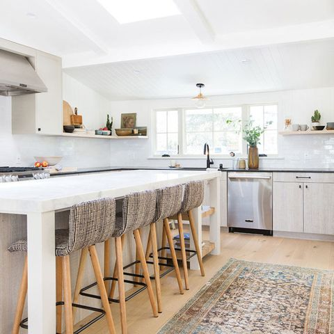 "<p>Everything is kept clean and fresh in this California kitchen, right down to the matches-everything neutrals of&nbsp;the stools and over-dyed rug.&nbsp;</p><p><strong data-redactor-tag=""strong"" data-verified=""redactor"">See more at </strong><a href=""http://amberinteriordesign.com/before-after-my-kitchen/"" target=""_blank"" data-tracking-id=""recirc-text-link""><strong data-redactor-tag=""strong"" data-verified=""redactor"">Amber Interiors</strong></a><strong data-redactor-tag=""strong"" data-verified=""redactor"">.</strong></p>"