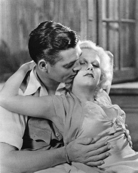 """<p>Jean Harlow, the original Blonde Bombshell, was hugely popular in 1930s Pre-Code Hollywood and liked to wear really clingy dresses without a bra (the horror!). Here she is with Clark Gable, her co-star in <em data-redactor-tag=""""em"""">Red Dust</em>.</p>"""