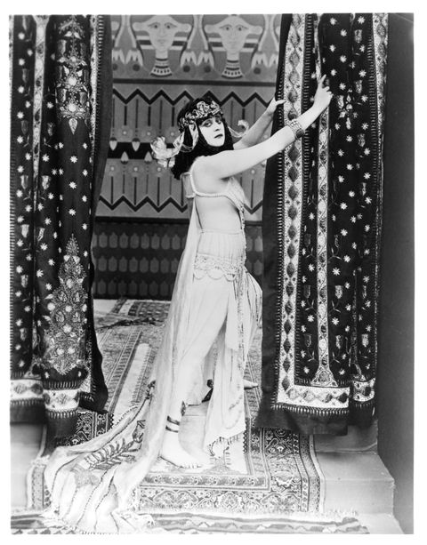 """<p>The actress Theda Bara — one of Hollywood's first ever sex symbols and femme fatales — starred in the title role of the 1917 silent film <em data-redactor-tag=""""em""""><a href=""""https://www.youtube.com/watch?v=OWn7L2pL5dI"""" target=""""_blank"""" embed_count=""""1"""">Cleopatra</a></em>, wearing expensive and racy costumes that included a coiled snake bra that wrapped around her bare breasts. Censors required cuts of scenes that included Bara's """"objectionable costume"""" and """"costume exposing body."""" Sadly, most of the film is now lost because the last remaining prints were destroyed. </p>"""