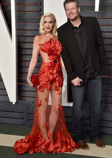 <p>Props to Blake Shelton for managing to keep his eyes off of girlfriend Gwen Stefani's Oscars' after-party dress (additional props to cascading petals for providing all the coverage Gwen needed).</p>
