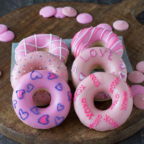 Doughnut, Food, Dessert, Baked goods, Cuisine, Pink, Finger food, Ciambella, Snack, Sweetness,