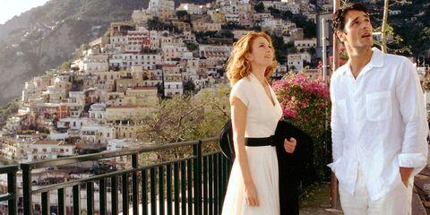 Trousers, Dress, Photograph, Formal wear, Tourism, Beauty, Hill, Waist, Travel, Mountain range,