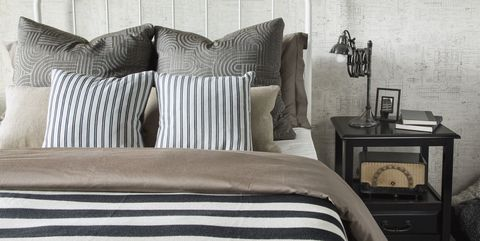 Brown, Interior design, Textile, Room, Wall, Linens, Bedding, Cushion, Bed, Pillow,