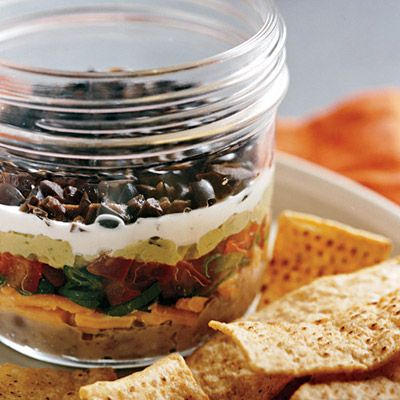 """<p>While the gang gets settled, break out the chips and a batch of this zesty Southwestern-style dip.</p><br /><p><b>Recipe: <a href=""""/recipefinder/seven-layer-bean-dip-recipe"""" target=""""_blank"""">Seven-Layer Bean Dip</a> </b></p>"""