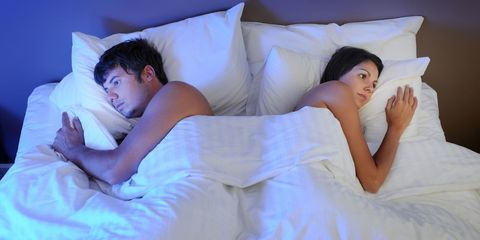 couple in bed sad