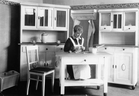 <p>By the early '20s, the piecemeal kitchen, with its freestanding Hoosier cabinet, stove, and work table, was being replaced with all-in-one configurations. </p>