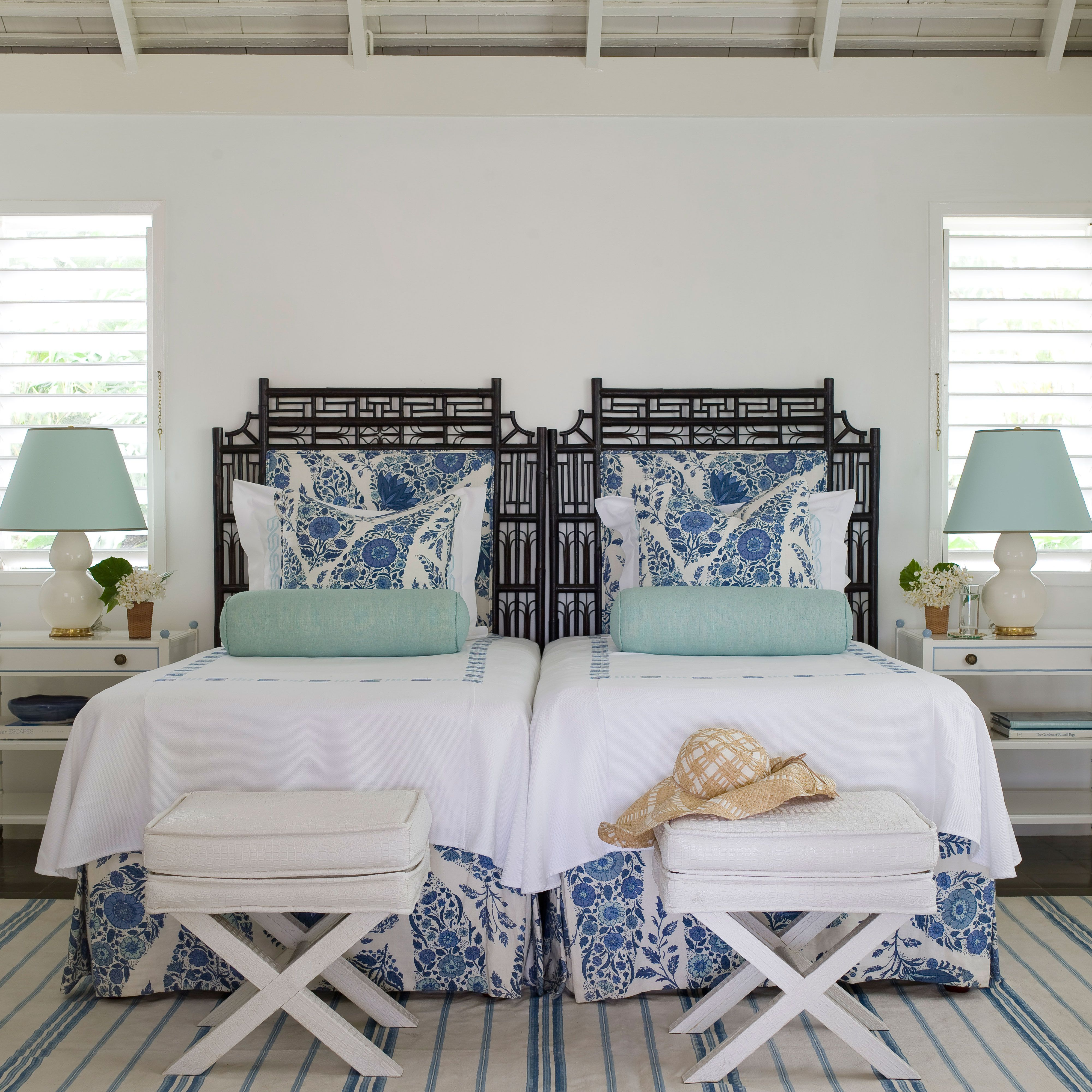 "<p>When the color scheme is this pared-down, it gives you license to really play with prints. The secret is so simple: ""Vary the scale and location of the prints,"" advises Braff. For example, the oversize floral pillows on the bed contrast so well with the skinny-striped rug on the floor.</p>"