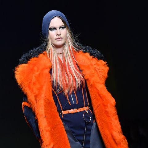 Fur clothing, Orange, Costume design, Fashion model, Electric blue, Fur, Animal product, Beanie, Street fashion, Costume,