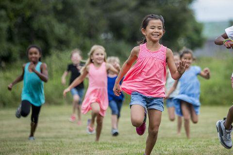 Kids playing tag at recess.