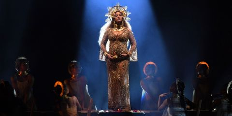 Stage, heater, Crown, Headpiece, Sculpture, Theatre, Fashion design, Hair accessory, Haute couture, Performing arts center,