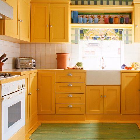 Cabinetry, Kitchen, Room, Furniture, Orange, Yellow, Countertop, Property, Cupboard, Floor,