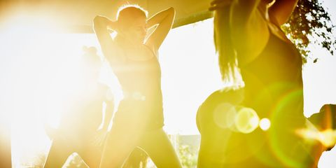 Yellow, Amber, Backlighting, Interaction, Light, People in nature, Lens flare, Pop music, Rock concert, Music venue,