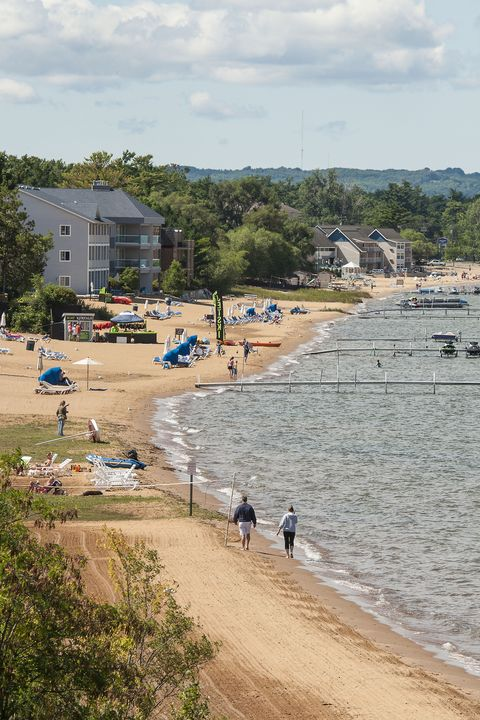 """<p>This coastal city is a calm, sleepy lakeside residence—until thousands of visitors flock to its shores and wineries come beach season. In addition to offering standard seaside activities, Traverse City's climate is also perfect for its two booming crops—wine and cherries.</p><p><em data-redactor-tag=""""em"""">For more information, visit <a target=""""_blank"""" href=""""http://www.traversecity.com/"""">traversecity.com</a>.</em></p>"""