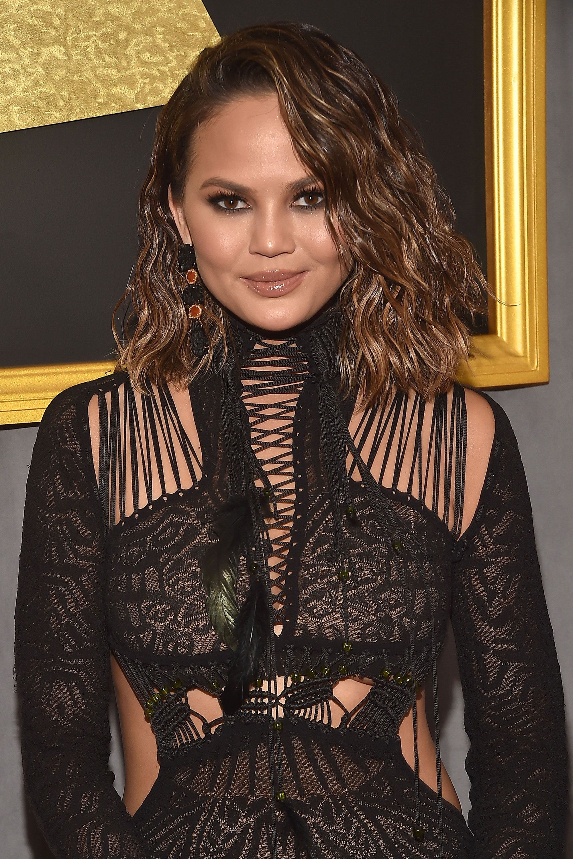 """<p>In a 2014&nbsp&#x3B;interview with <a href=""""http://www.cosmopolitan.com/entertainment/news/a24251/chrissy-teigen-on-june-2014-cosmo/"""" data-tracking-id=""""recirc-text-link"""" target=""""_blank""""><em data-redactor-tag=""""em"""" data-verified=""""redactor"""" data-tracking-id=""""recirc-text-link"""">Cosmopolitan</em></a>, Teigen discussed how she and husband John Legend keep things fun in the bedroom...and outside of it, too. """"We're by no means freaky-deaky, but let's just say, we're open to things,"""" she said. """"We're very OK with PDA. When we go to a restaurant, he loves when I wear a dress, so he can do some upper-thigh rubbing. I would love to see more husbands and wives making out!"""" She also revealed that the two of them are members of the mile-high club — which they joined while they were on a flight to visit family. """"We were on our way to Thailand to see my parents, flying commercial first-class,"""" she said. """"We were under a blanket. We weren't even in one of those pod things. I feel like we should get a trophy for that."""" But that's not all! Two years later, on <em data-redactor-tag=""""em"""" data-verified=""""redactor""""><a href=""""http://www.redbookmag.com/love-sex/relationships/a47495/chrissy-teigen-john-legend-public-sex/"""" target=""""_blank"""" data-tracking-id=""""recirc-text-link"""">Watch What Happens Live</a></em>, the couple revealed even more places they've had sex, including at a campaign event for Barack Obama in 2008 and a Fred Segal boutique in Los Angeles.&nbsp&#x3B;</p>"""