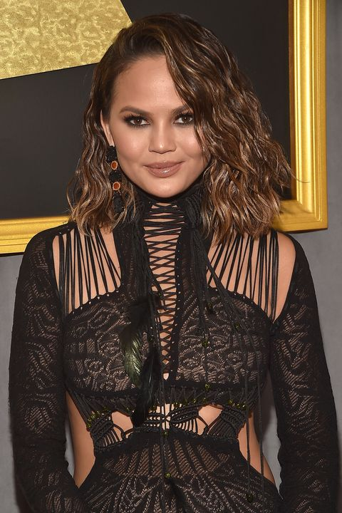 "<p>In a 2014&nbsp;interview with <a href=""http://www.cosmopolitan.com/entertainment/news/a24251/chrissy-teigen-on-june-2014-cosmo/"" data-tracking-id=""recirc-text-link"" target=""_blank""><em data-redactor-tag=""em"" data-verified=""redactor"" data-tracking-id=""recirc-text-link"">Cosmopolitan</em></a>, Teigen discussed how she and husband John Legend keep things fun in the bedroom...and outside of it, too. ""We're by no means freaky-deaky, but let's just say, we're open to things,"" she said. ""We're very OK with PDA. When we go to a restaurant, he loves when I wear a dress, so he can do some upper-thigh rubbing. I would love to see more husbands and wives making out!"" She also revealed that the two of them are members of the mile-high club — which they joined while they were on a flight to visit family. ""We were on our way to Thailand to see my parents, flying commercial first-class,"" she said. ""We were under a blanket. We weren't even in one of those pod things. I feel like we should get a trophy for that."" But that's not all! Two years later, on <em data-redactor-tag=""em"" data-verified=""redactor""><a href=""http://www.redbookmag.com/love-sex/relationships/a47495/chrissy-teigen-john-legend-public-sex/"" target=""_blank"" data-tracking-id=""recirc-text-link"">Watch What Happens Live</a></em>, the couple revealed even more places they've had sex, including at a campaign event for Barack Obama in 2008 and a Fred Segal boutique in Los Angeles.&nbsp;</p>"