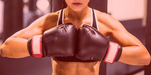Boxing glove, Muscle, Arm, Boxing, Shoulder, Boxing equipment, Abdomen, Glove, Sport venue, Bodybuilding,