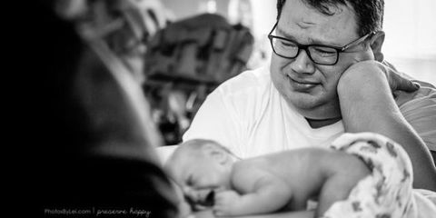 dad overcome with emotion at rainbow baby