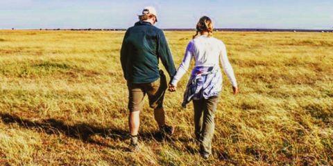 People in nature, Grassland, Prairie, Grass, Walking, Grass family, Field, Friendship, Ecoregion, Gesture,