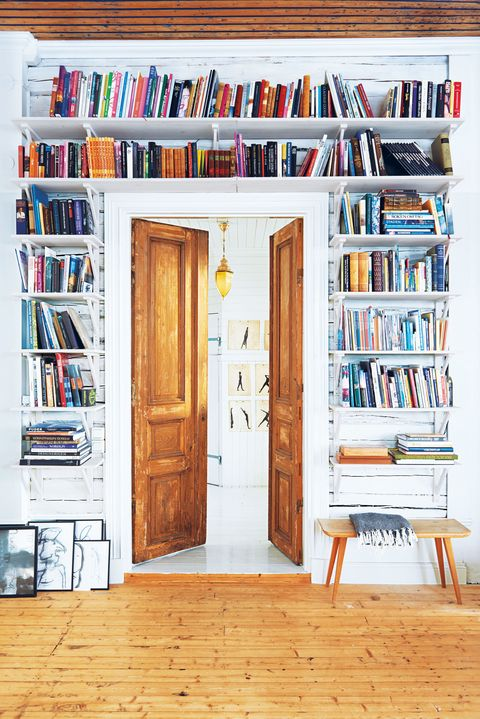 "<p>The space surrounding a door is often neglected, but it can be put to good use with floor-to-ceiling shelves that proudly show off your collection of <a href=""http://www.redbookmag.com/life/g4190/spring-2017-must-read-books-female-authors/"" target=""_blank"" data-tracking-id=""recirc-text-link"">book-club picks</a>. It creates a cozy, <a href=""http://www.redbookmag.com/home/g4159/book-storage-ideas/"" target=""_blank"" data-tracking-id=""recirc-text-link"">library</a>-ish feel, no magic styling formula required. Even those frames you've been meaning to hang can look artful together leaning against a wall.</p>"