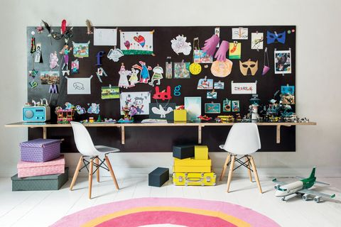 "<p>Kids just have so… much… stuff. Instead of fighting against the chaos, work with it. Tack all those souvenirs, <a href=""http://www.redbookmag.com/home/decor/features/g2668/diy-easter-crafts/"" target=""_blank"" data-tracking-id=""recirc-text-link"">craft projects</a>, and random thingamabobs onto a big bulletin board and the mess suddenly becomes something interesting to look at. Then mount a long shelf below it to create a super long <a href=""http://www.redbookmag.com/home/decor/g773/desk-makeovers/"" target=""_blank"" data-tracking-id=""recirc-text-link"">desk</a> — and think of it as a genius bar for your children's imaginations.</p><p><strong data-redactor-tag=""strong"" data-verified=""redactor"">RELATED:&nbsp;</strong><span><a href=""http://www.redbookmag.com/home/decor/tips/g2358/decor-hacks/""></a><strong data-redactor-tag=""strong"" data-verified=""redactor""><a href=""http://www.redbookmag.com/home/decor/tips/g2358/decor-hacks/"" target=""_blank"" data-tracking-id=""recirc-text-link"">17 Affordable Decorating Hacks From Top Designers</a></strong></span></p>"