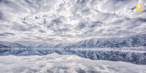 Daytime, Cloud, Atmosphere, Winter, Cumulus, Mountain range, Space, Snow, Geological phenomenon, Freezing,