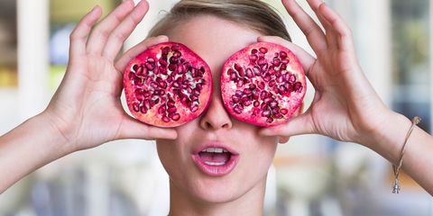 Pomegranate, Fruit, Food, Superfood, Skin, Lip, Natural foods, Hand, Mouth, Human,