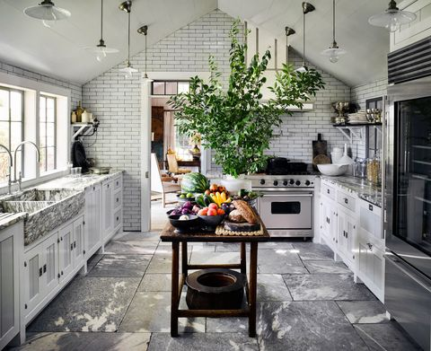 "<p>Vaulted ceiling aside, a film-set-worthy kitchen of your own is not out of reach. Just try these ideas. </p><p><strong data-redactor-tag=""strong"">1. Layer on the neutrals.</strong> Always sophisticated: crisp whites, cool stainless, and lots of natural materials. For major bang for your buck, focus on subway tiles and a slate floor instead of pricey marble countertops. Then warm up those <a href=""http://www.redbookmag.com/home/a41851/clear-out-kitchen-clutter/"" target=""_blank"" data-tracking-id=""recirc-text-link"">sleek surfaces</a> with a rustic table that serves as a <a href=""http://www.redbookmag.com/home/decor/features/g2796/genius-kitchen-island-diys/"" target=""_blank"" data-tracking-id=""recirc-text-link"">kitchen island</a> and wooden boards and bowls. </p><p><strong data-redactor-tag=""strong"">2. Hang stylish lighting.&nbsp;</strong><span>Think of fixtures as the statement earrings of a monochromatic room — there to <a href=""http://www.redbookmag.com/home/g2716/16-chic-accessories-that-glam-up-your-kitchen-immediately/"" target=""_blank"" data-tracking-id=""recirc-text-link"">bring the sparkle</a> and pull the whole look together. The more pendants you use, the bigger their impact.</span></p><p><strong data-redactor-tag=""strong"">3. Liven it up with greenery.&nbsp;</strong><span>You don't need to have a florist on call either. Head out to the yard and <a href=""http://www.redbookmag.com/home/news/g2979/best-plants-for-a-garden/"" target=""_blank"" data-tracking-id=""recirc-text-link"">clip a few branches</a> to drop into a vase. It'll remind you of the lush arrangements you'd see in a high-end hotel lobby.</span></p>"