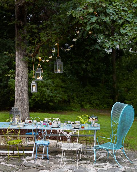 <p>Matching set not required. Colorful vintage furniture can suit any landscape (and budget). To keep painted metal pieces in tip-top shape, coat them in a rust-preventive clear or colored spray paint like Rust-Oleum.</p>