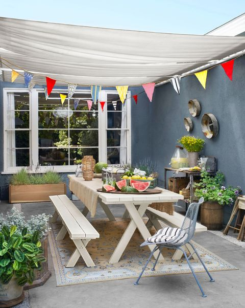 <p>Be it a tiny slab of concrete or a lush deck, your haven is worthy of the alfresco treatment. In lieu of a leafy elm, you can hang a shade sail (attach each end to the roof, a wall, or poles in the yard) to block UV rays and keep everyone cool.</p>
