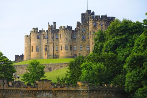 "<p>This <a href=""https://www.alnwickcastle.com"" target=""_blank"">British estate</a> is still home sweet home to the current Duke of Northumberland, but it's also stood in for two fictional forts: Hogwarts in the first two <em data-redactor-tag=""em"">Harry Potter</em> movies and Brancaster Castle in <em data-redactor-tag=""em"">Downton Abbey</em>. </p>"