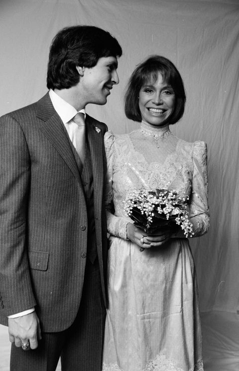 "<p>Mary Tyler Moore chose a more subdued version of an on-trend '80s look: Gathered sleeves and a high lace neckline.&nbsp;</p><p><a href=""http://www.goodhousekeeping.com/beauty/fashion/a33719/wedding-dress-trends-through-the-years/"" target=""_blank"" data-tracking-id=""recirc-text-link""><em data-redactor-tag=""em"">See the evolution of the wedding dress&nbsp;»</em></a><span class=""redactor-invisible-space"" data-redactor-tag=""span"" data-redactor-class=""redactor-invisible-space"" data-verified=""redactor""><a href=""http://www.goodhousekeeping.com/beauty/fashion/a33719/wedding-dress-trends-through-the-years/""></a></span><span class=""redactor-invisible-space"" data-verified=""redactor"" data-redactor-tag=""span"" data-redactor-class=""redactor-invisible-space""></span><br></p>"