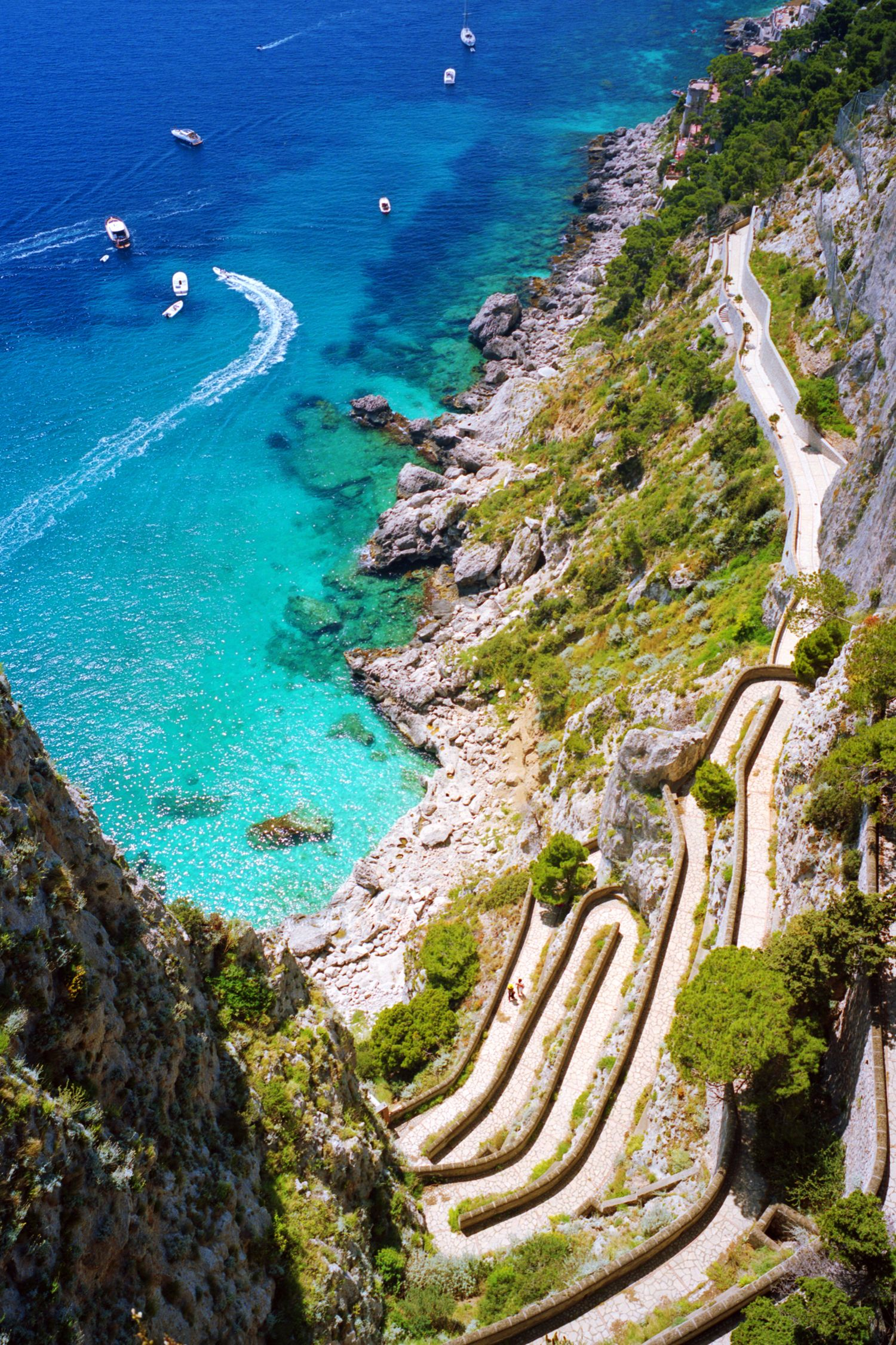 <p>Located just off the Amalfi Coast, the entire island of Capri is full of picturesque spots. To capture this iconic shot of rocky cliffs meeting the sea, head to the Augustus Gardens where this switchback path leads down to the Marina Piccola.</p>