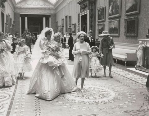 <p>Princess Diana walks with Hambro and Queen Elizabeth.</p>