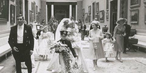 Photograph, Suit, Dress, Monochrome, Ceremony, Picture frame, Classic, Vintage clothing, Monochrome photography, Bouquet,