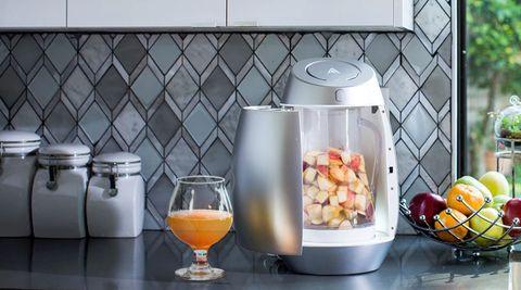Candy corn, Small appliance, Room, Kitchen appliance, Food, Juicer, Home appliance, Blender, Drink, Jug,