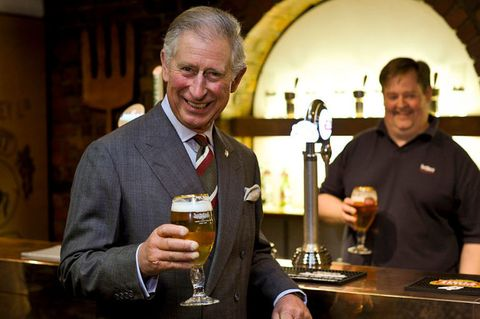 Prince Charles drinking a pint of beer