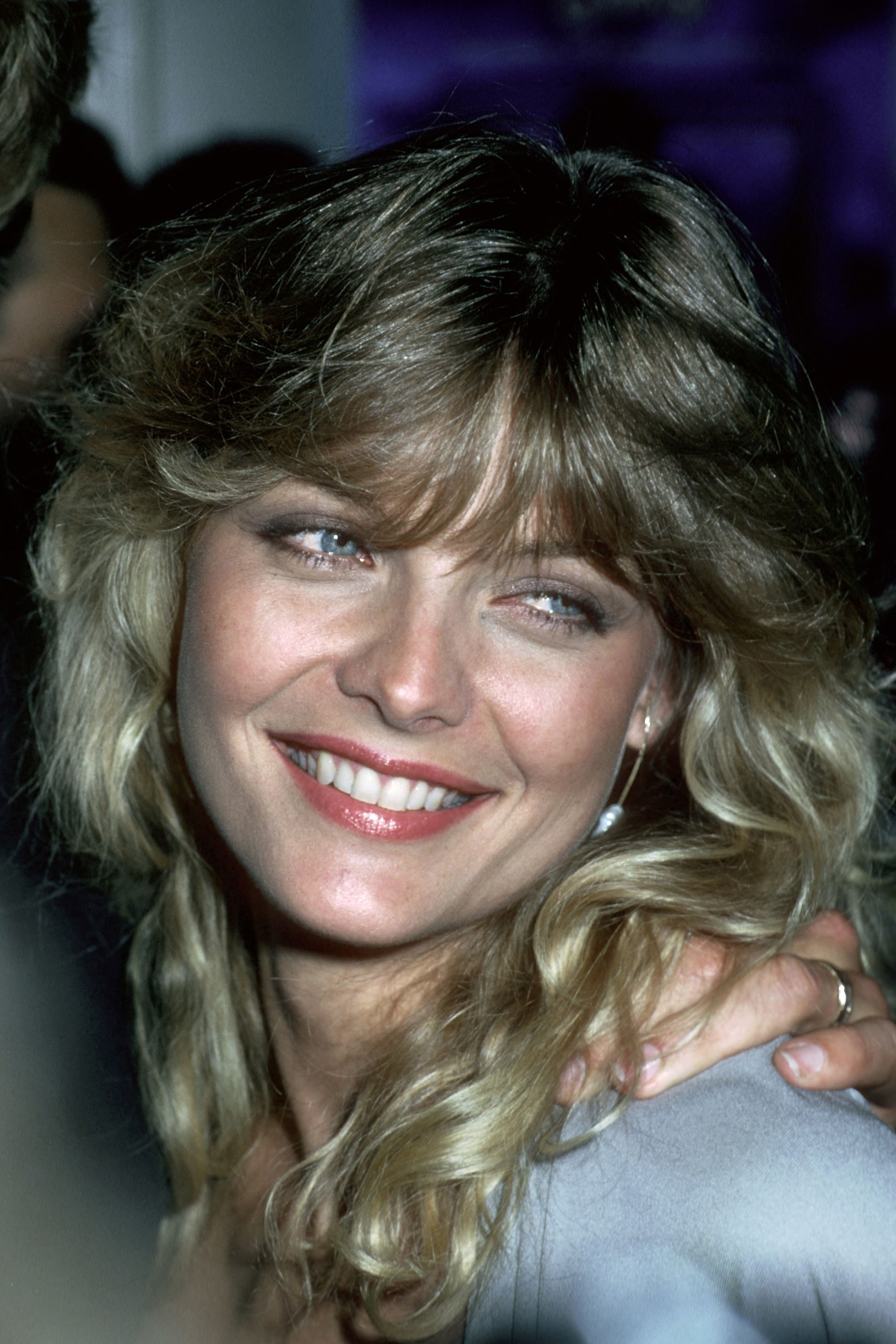 """<p>If Michelle Pfeiffer's layered, fanned-out bangs don't give you serious <em data-redactor-tag=""""em"""">Grease 2 </em>vibes, nothing will. </p>"""