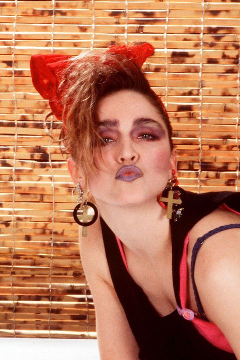 <p>Madonna was all kisses for the lip shade of the year: muted purple. </p>